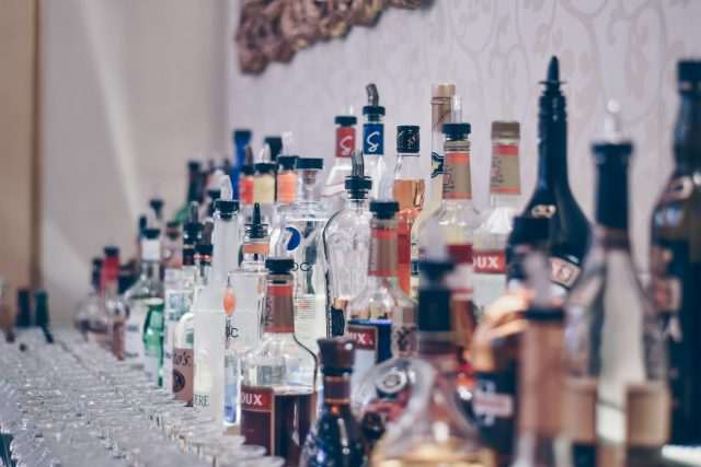 Different Vodka's Lined Up being A Glass Bar