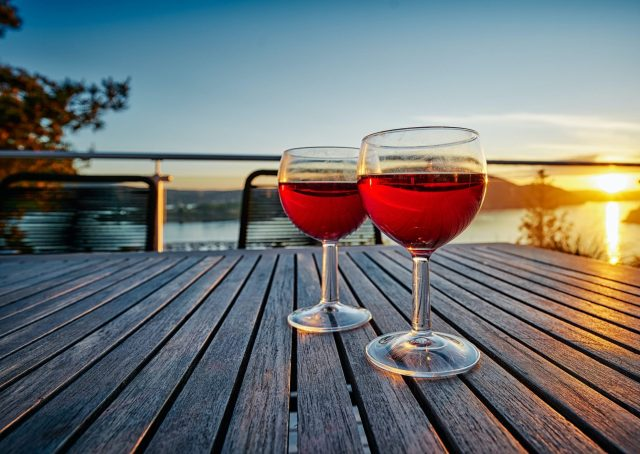 2 Glasses of red wine at sunset