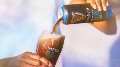 Guinness Alcohol Free 0.0% Being Poured into a branded pint glass