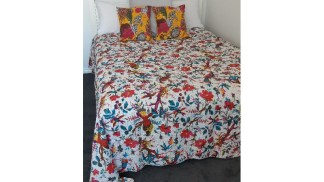 white bed and tropical bedding