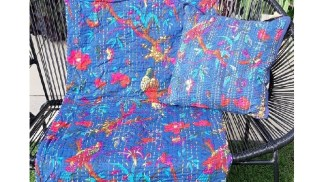 bright coloured throw blanket and cushion on outdoor chair