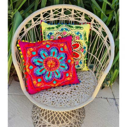 Embroidered cushions on mid century chair