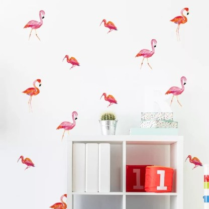 White cube bookcase with flamingo wall decals in background