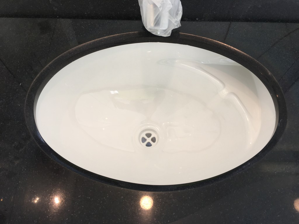 Under top basin resurfacing