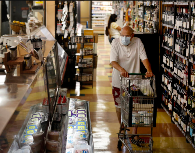 Serge Zimberoff shops for groceries at Pacific Market in Santa Rosa, California, on Monday, August 10, 2020. (Beth Schlanker/The Press Democrat)