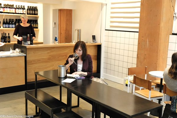 Photo of Nancy Croisier tasting at Foundry Vineyards Seattle courtesy of Richard Duval Images