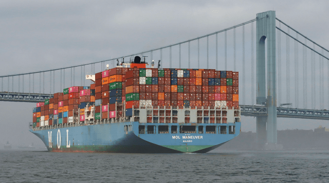 Container ships have been sitting offshore, waiting for dock space to unload, keeping customers waiting. (Gary Hershorn/Getty)