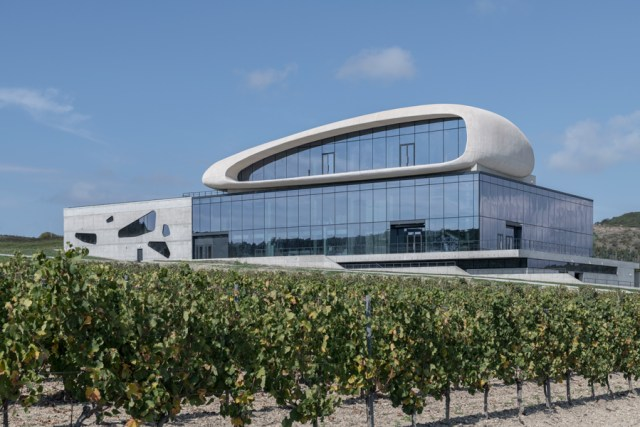 The play between orthogonal and organic forms defines this winery designed for winemaker Cote Rocheuse outside of the Russian city of Krasnodar. Courtesy Severin Proekt and Daniel Annenkov