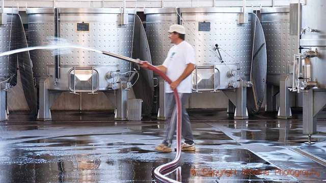 Cleaning the wine cellar and steel tanks with water, copyright BKWine Photography