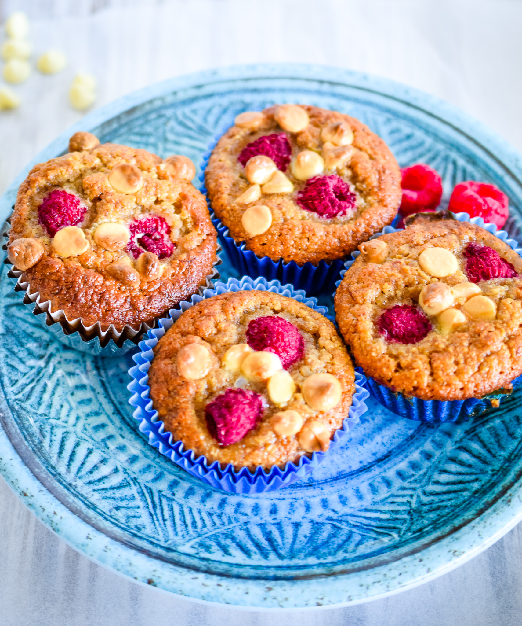 A plate of raspberry and white chocolate muffins