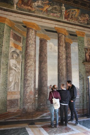 Three award-holders inspect the graffiti in the upstairs of the Villa Farnesina