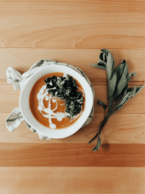Futsu Squash + Sweet Potato Soup (with Turmeric, Coconut Milk + Kale Chips) : A little slice of Autumn in a bowl. This Futsu Squash Sweet Potato Soup recipe is sure to give your heart and stomach all the warm and yummy fall feels. Gluten + Dairy Free, Whole30 + Paleo-friendly!