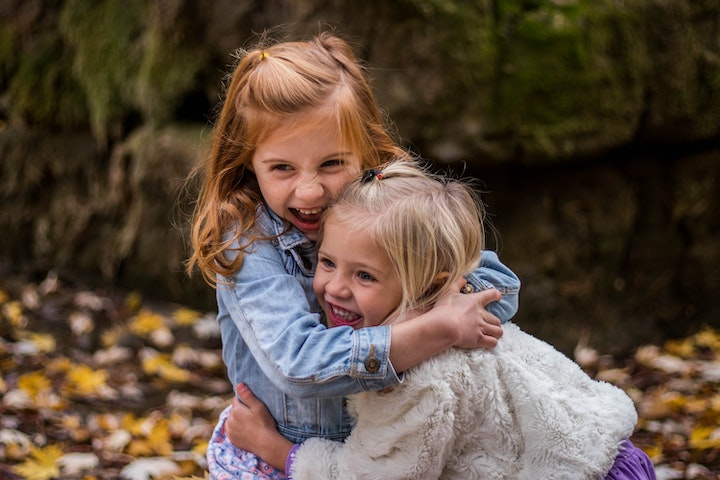 Picture of two happy young girls. Child Counseling for adoption, ADHD, depression and anxiety in Houston & Katy, TX 77079