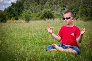 A child meditating.  Brittani Persha Counseling provides counseling for preschoolers, children with ADHD, anxiety, behavior problems and teenagers in Houston, TX 77079