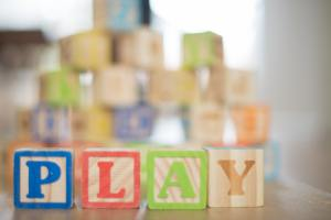 Picture of blocks spelling play to represent how Family Therapists use Play Therapy and Counseling for Children in Houston & Katy, TX 77079.