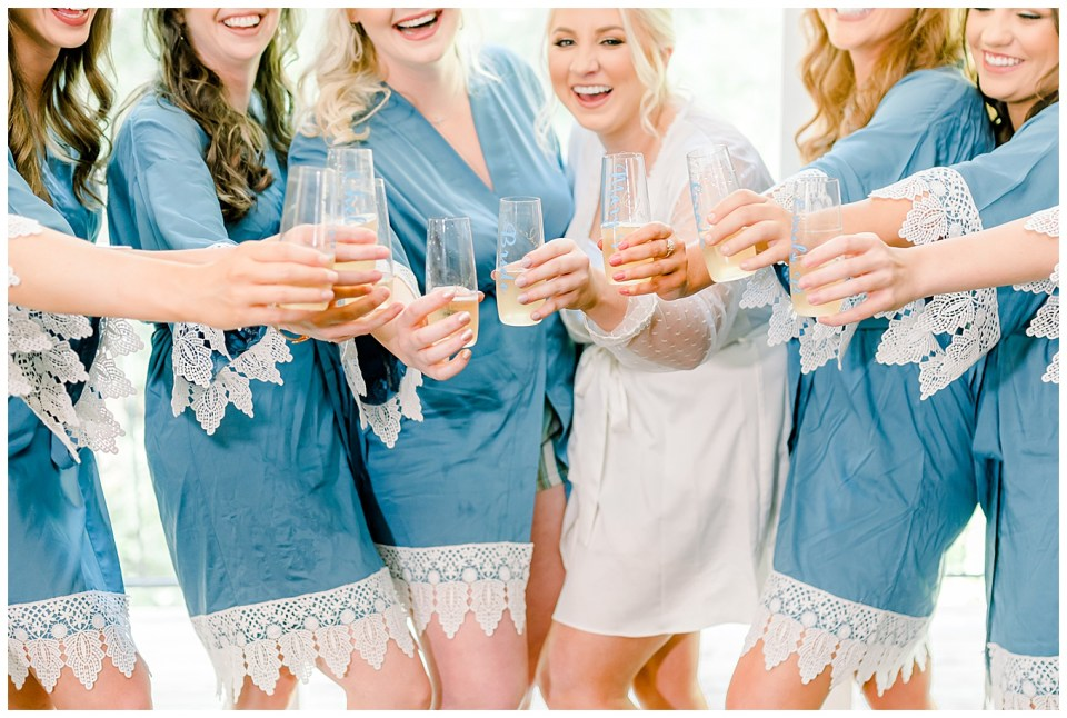 bride and her bridesmaids toasting baton rouge wedding day