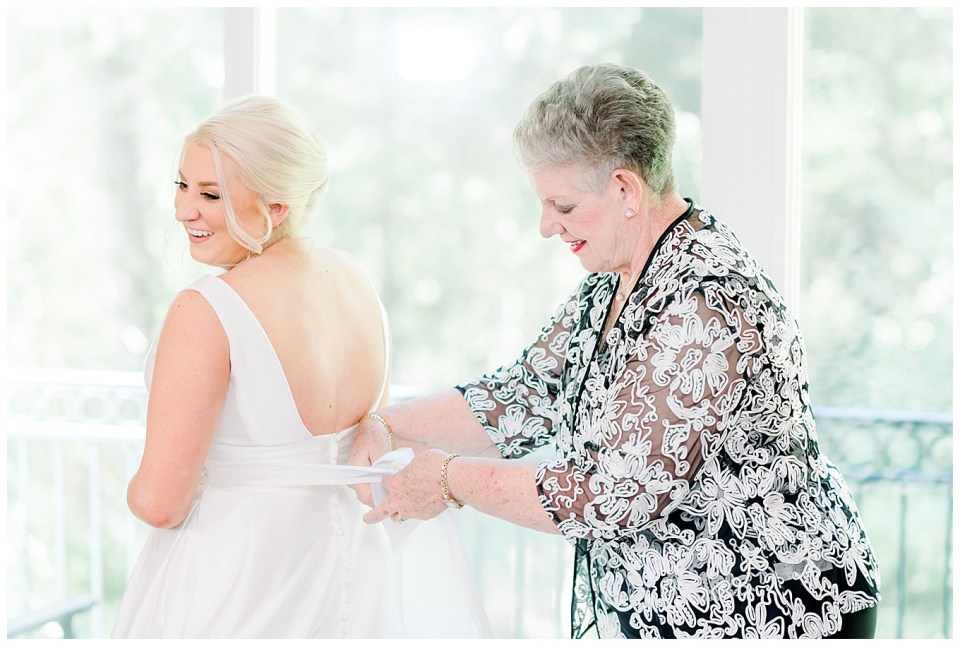 bride getting ready with grandmother