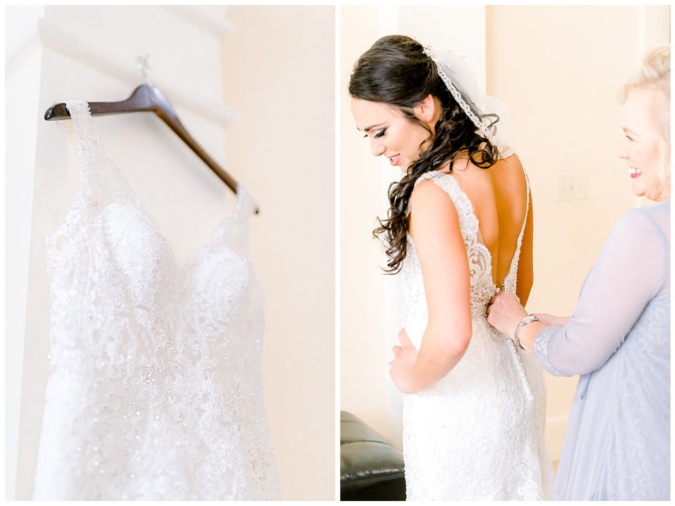 bride getting zipped up into her dress with mom