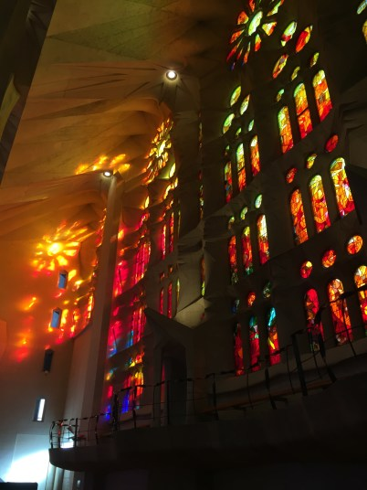 light illuminating the stained glass windows of La Sagrada Familia in Barcelona