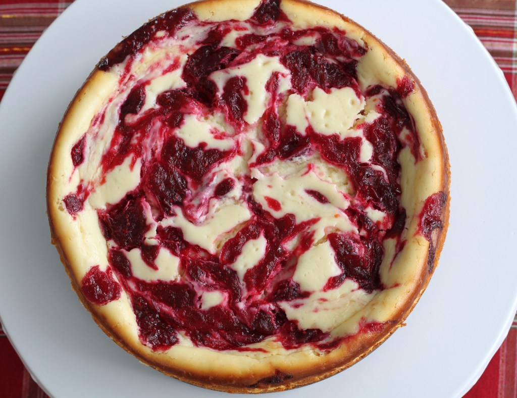 White Chocolate Cranberry Swirl Cheesecake is a showstopper of a holiday dessert! {Brittany's Pantry}