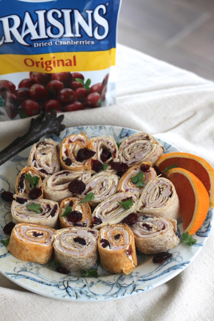 These Cranberry-Orange Pinwheels and perfect for lunches or even a game day crowd. Especially with the addition of smoked turkey and the kick of Sriracha! {Brittany's Pantry}