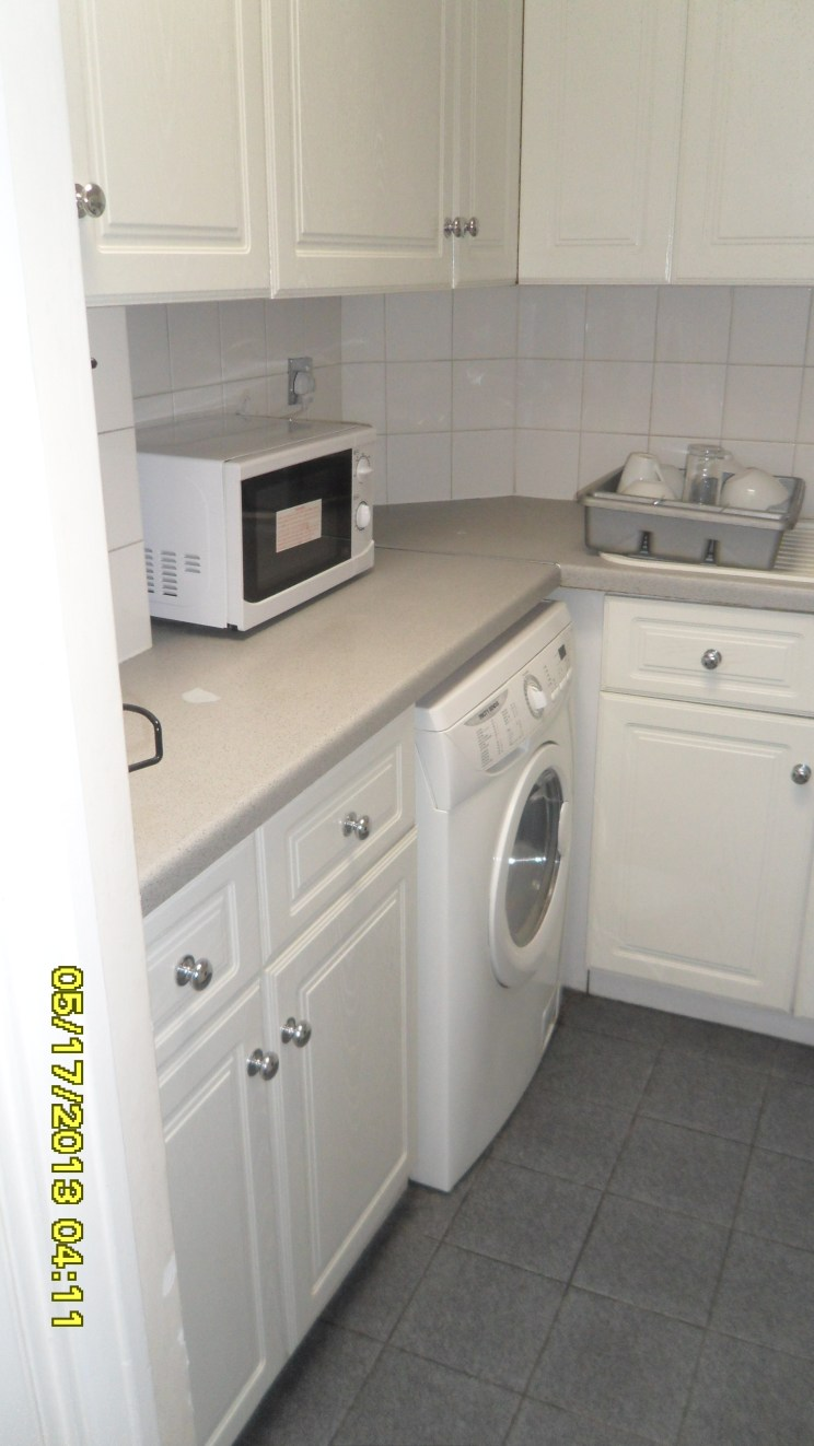 the tiny washer/dryer in the kitchen