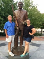 dad and I in front of a statue