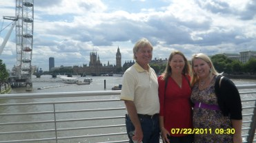 family in front of Big Ben and the London Eye