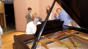 Bryce playing the piano