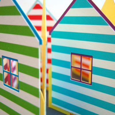 A close up detail of the Beach Hut cards showing blue with green stripes and purple with blue stripes.