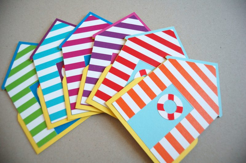 A range of Beach Hut cards in various colours and stripes, front view.