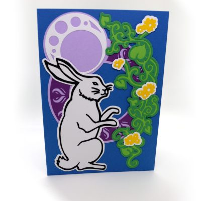 Moonlight Rabbit Greetings Card, layered paper cut design, isolated view.