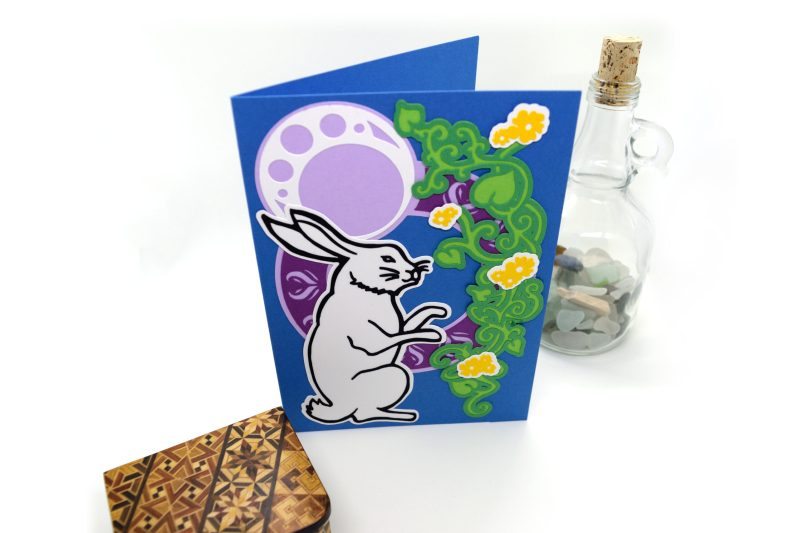 Moonlight Rabbit Greetings Card, layered paper cut design, top down view.
