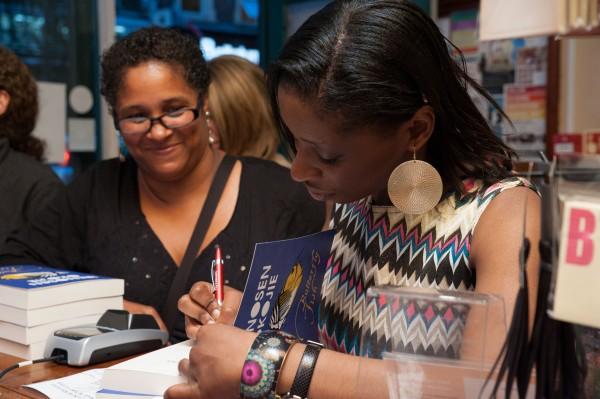 Irenosen Okojie signs a copy of Butterfly Fish for award-winning novelist Yvette Edwards