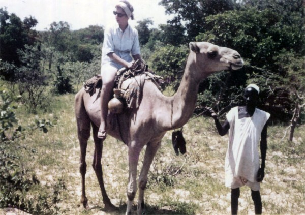 On the camel in Niger, with the camel herder in control, during the trip with Roger and John in 1963