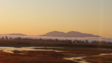 Sunrise over the mountains an hour north of San Francisco from Amtrak's Pacific Surfliner train.