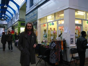 Dougald Hine in Brixton Village outside a pop-up sweet shop