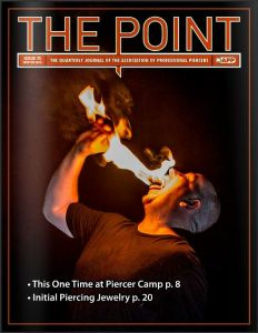 The point # 73 cover - Rob Hill eats fire while at camp APP