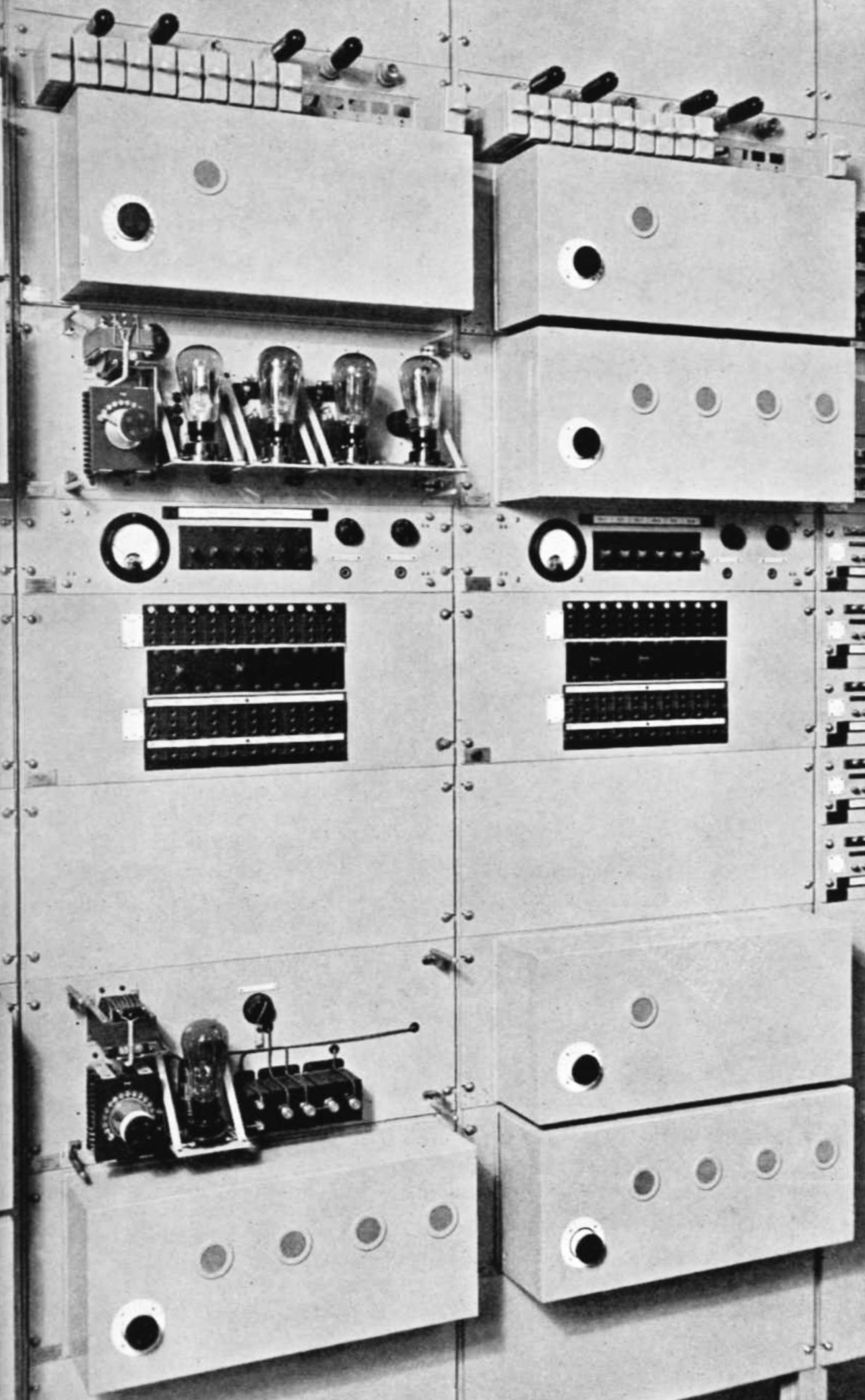 Valves, dials and control knobs on a vertical bank of equipment
