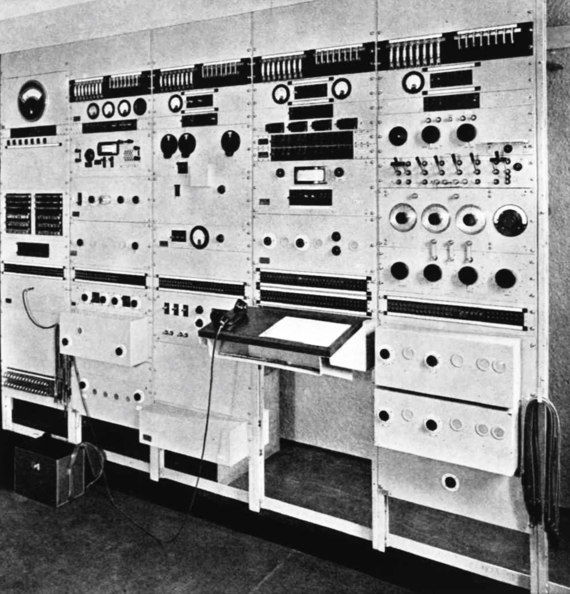 5 vertical panels with dials, switches and knobs