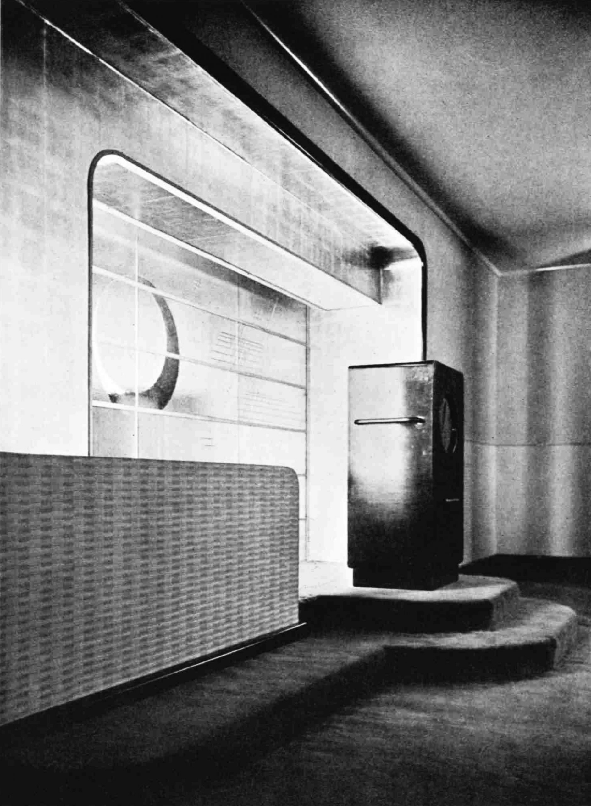 A large radio sits in front of a decorated recess
