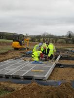 laying the blocks between the beams