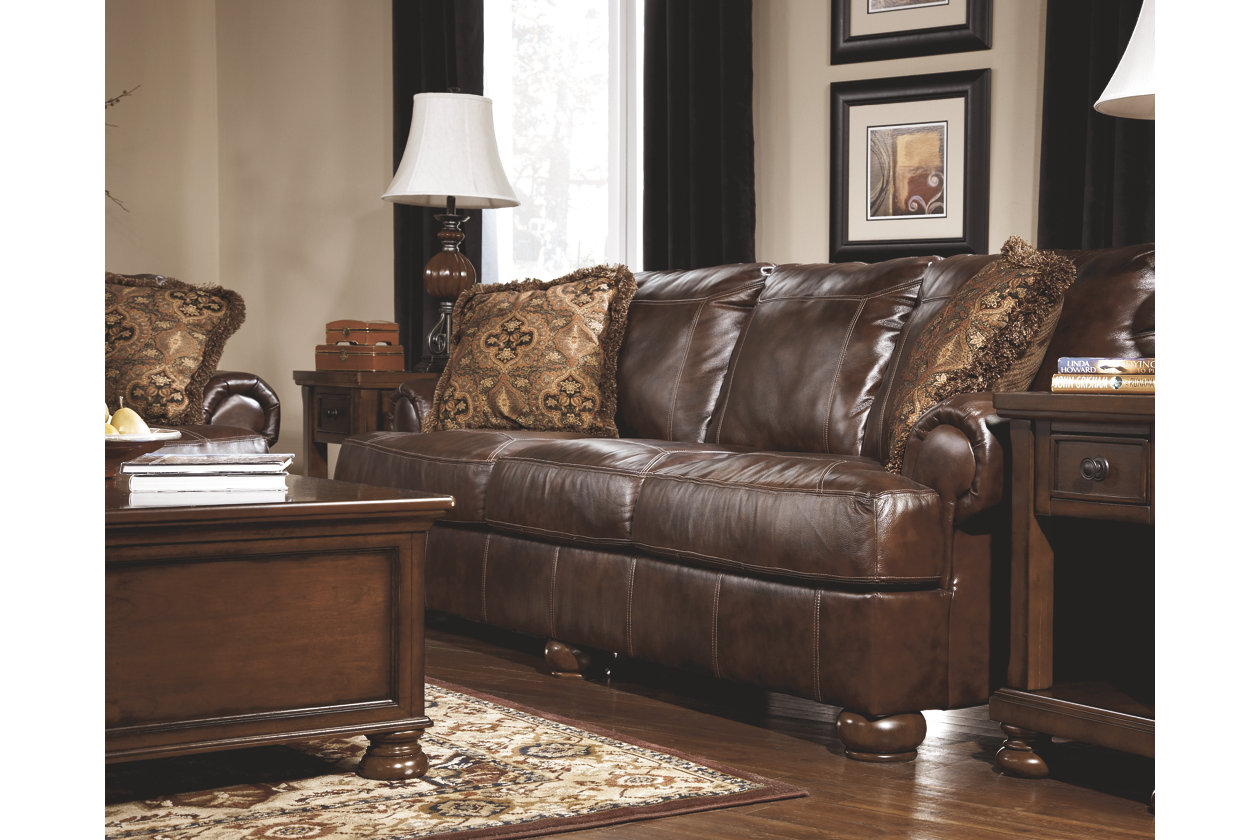 ashley axiom leather sofa microfiber uk walnut signature design by broadway