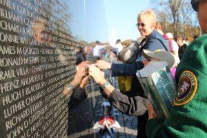 visitors to the vietnam veterans memorial on veterans day credit elvert barnes