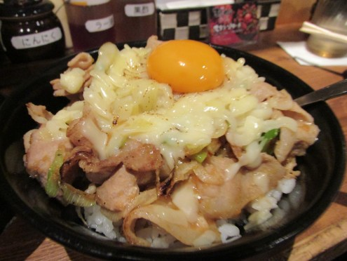 """Sutameshi"", and yes that's a raw egg on top (it cooked due to the heat of the meat, cheese, and rice underneath)"