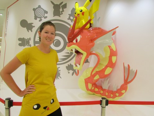 Julia standing fearless in front of a Pikachu-mounted Gyarados