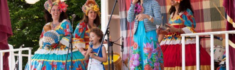Performers on stage at Brockley Max Art In The Park