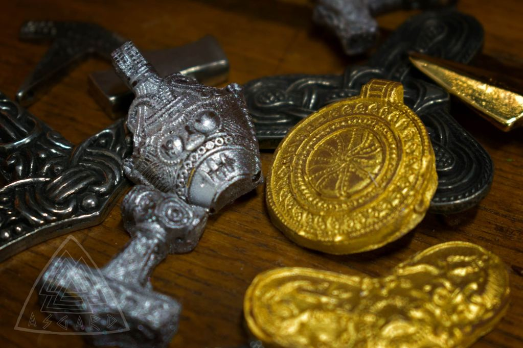 Chocolate Viking Hoard: Viking Sun Disc and Loki Mask made in chocolate. The Brodgar Chocolate Viking Hoard contains 7 pieces, in milk and dark chocolate: 1 Trefoil Brooch, 2 Sun Discs, 2 Thor's Hammers and 2 Loki Masks. Each is a chocolate replica of real Viking jewellery, made in collaboration with Nordens Historiska Fynd. Photo credit: Asgard.
