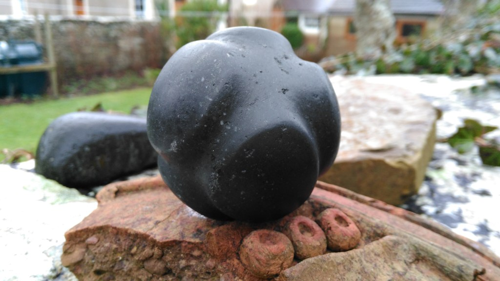 Ness of Brodgar type carved stone ball in camptonite, made on commission. Notice the natural crystals, that go in a band like the Milky Way. SOLD