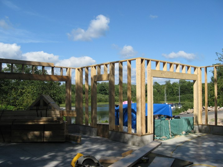 Partridge Bay Garage During Construction Framing Looking Out